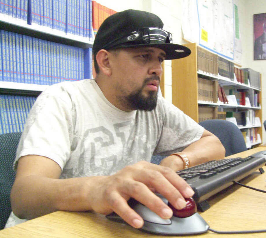 Steven Gonzales, a 9-year employee of Cargill, looks for work on a computer at the Unger Memorial Library. He's wanting to stay in the area and is hoping to find work in Lubbock. The library is among many others in the community reaching out to Cargill workers facing unemployment, waiving print fees for resumes and job applications. Photo: Shanna Sissom/Plainview Herald
