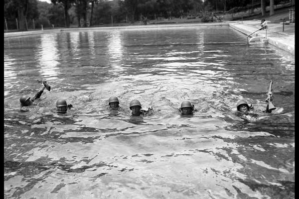 Douglass, Neal. Soldiers from Del Valle Army Air Base training in Deep Eddy pool, photograph, January 6, 1943; ( texashistory.unt.edu/ark:/67531/metapth34277/m1/1/:  accessed July 25, 2016), University of North Texas Libraries, The Portal to Texas History,  texashistory.unt.edu ; crediting Austin History Center, Austin Public Library.