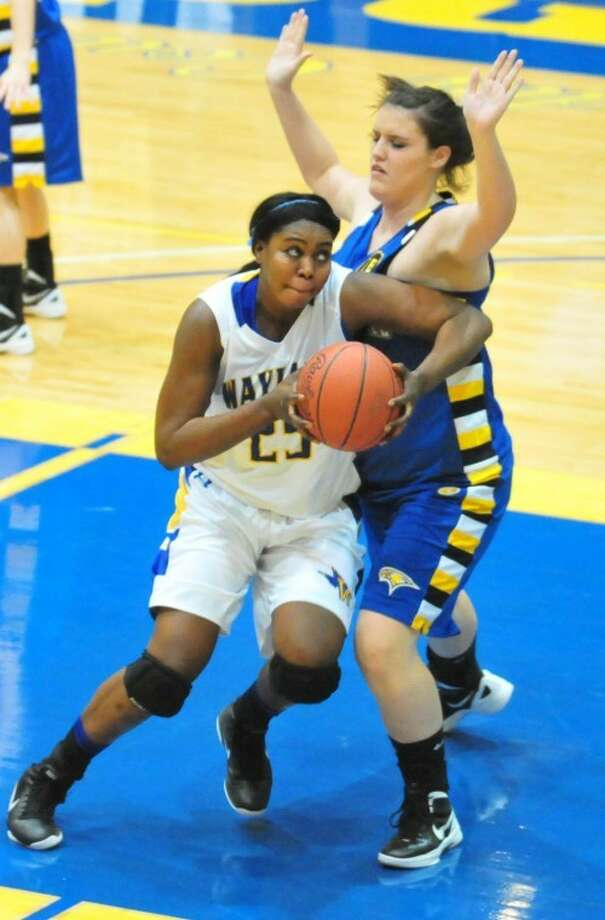 Wayland's Maty Diallo muscles her way to the basket against John Brown. Photo: Kevin Lewis/Plainview Herald