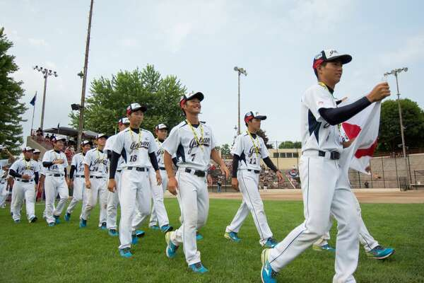 Team Japan at the opening ceremonies at the Junior World Championship Fastpitch softball tournament at Emerson Park Sunday.