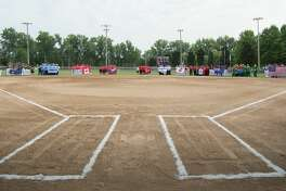 The opening ceremonies at the Junior World Championship Fastpitch softball tournament at Emerson Park Sunday.