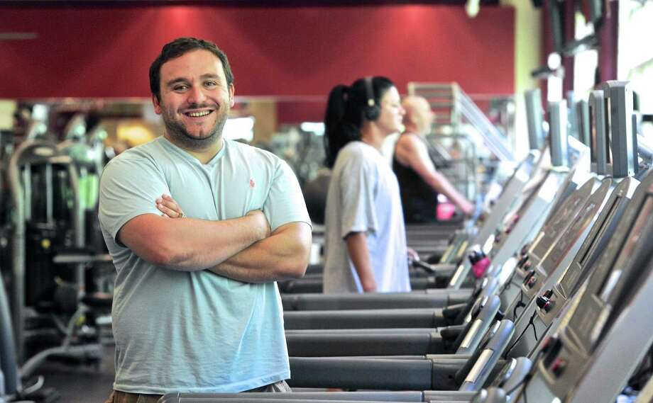 Dominick Donofrio Jr. stands among the treadmills of the New Milford Sports Club. Donofrio Jr. was arrested at his home in Roxbury Tuesday and taken into custody by state police, who made the arrest on behalf of the Department of Labor. Photo: H John Voorhees III / Hearst Connecticut Media / The News-Times