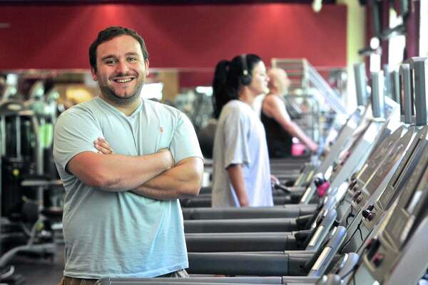 Dominick Donofrio Jr. stands among the treadmills of the New Milford Sports Club. Donofrio along with his father Dominick Donofrio Sr, are the new owners of the club. Monday July 18, 2016, in New Milford, Conn.