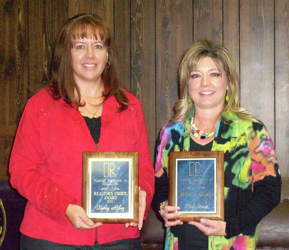 Courtesy PhotoDuring the Plainview Association of Realtors Installation Luncheon, Kathy Riley (left) of Billington Real Estate received the Realtor's Choice Award and Kim Street of Street Real Estate got the Pinnacle Award. Street has served on numerous committees and held several offices over the past decade. Riley has been on the board for two years and is 2012 president. / COPYRIGHT, 2007