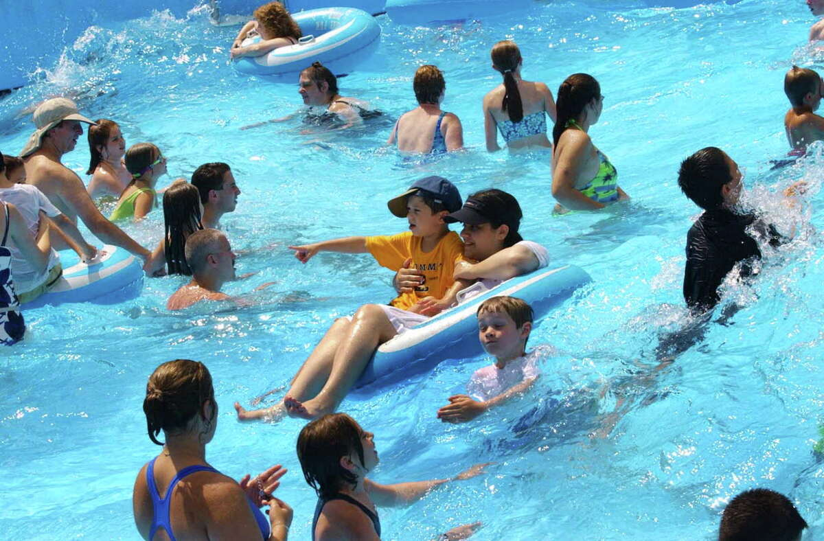 A crowd keeps cool in the wave pool at Water Slide World in Lake George, New York Wednesday July 3, 2002. (TIMES UNION STAFF PHOTO--MICHAEL P. FARRELL)