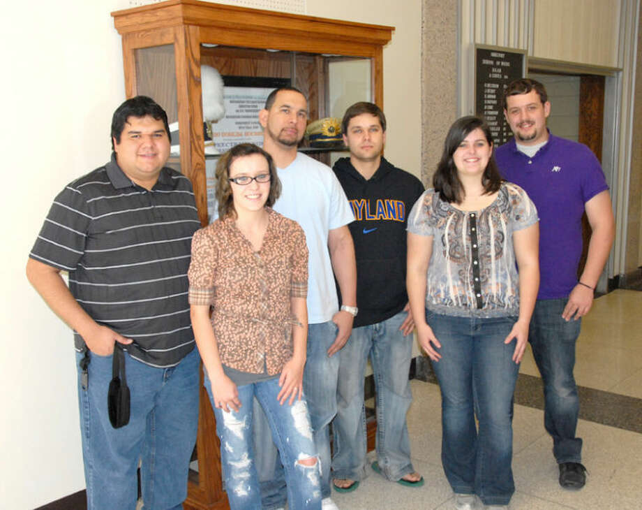Six members of the Wayland Baptist University band were selected to take part in the Small College Intercollegiate Band at the 2013 College Band Directors National Association national convention in North Carolina during March. They include Vincent Limon (left), Kaylie Young, Ken Walker, Stephen Holcomb, Lyndsey Dean and David Rogers. Photo: Wayland Baptist University Photo