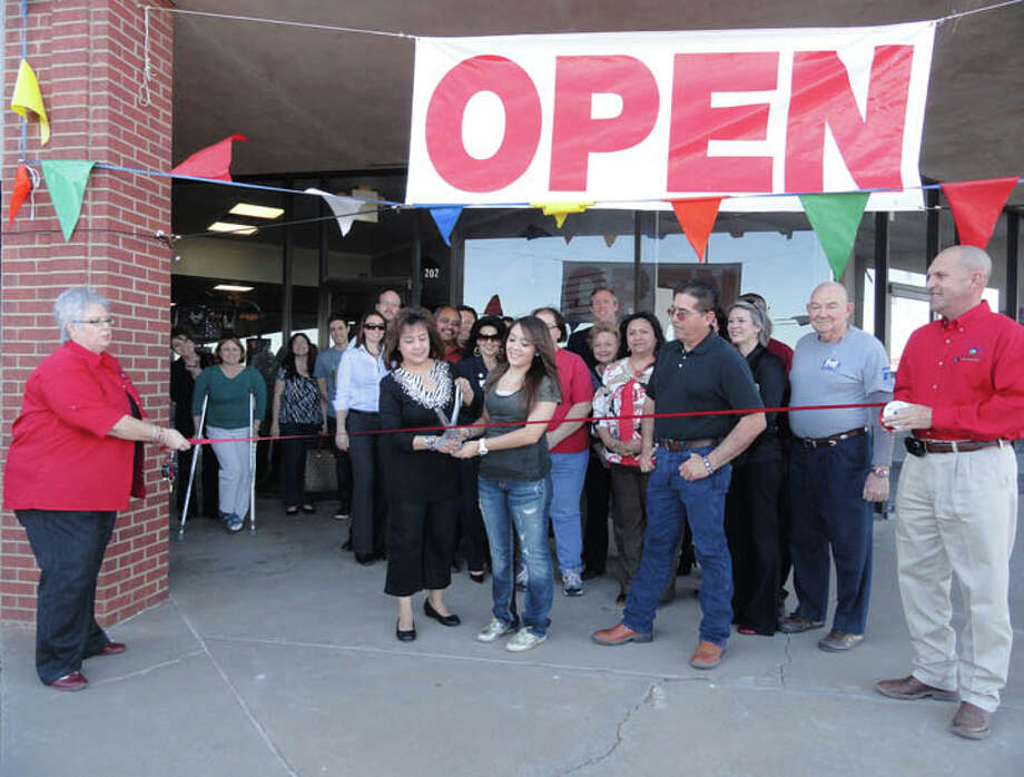 Carmen Ortega/Plainview HeraldWith Chamber of Commerce representatives Linda Morris (left) and Chris LeFevre holding the ribbon, owner Barbara Ramirez and daughter Brittany kick off grand opening ceremonies for B&B's Boutique on Thursday. Her husband, Ruben Ramirez, looks on. The new business, located in the Stonegate Shopping Center, features women's clothing and accessories. Ribbon cutting ceremonies were arranged by the Chamber of Commerce Red Coats Committee.