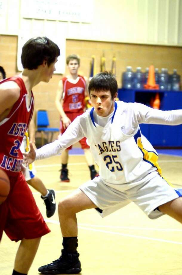 Nathan Morales (25) of Plainview Christian applies pressure to an Ascension Academy player during action Tuesday in the Eagle's Nest. The Eagles, ranked No. 2 in the state in Class 1A TAPPS, have won 16 straight games since a season-opening loss. They and the Lady Eagles host doubleheaders against Wichita Falls teams on Friday night and Saturday afternoon.