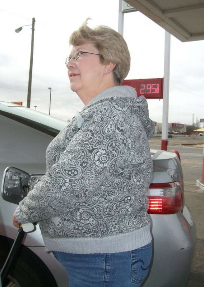 "Kevin Lewis/Plainview HeraldPeggy Newsom of Plainview pumps gas into her car at an Allsup's on Fifth Street where regular unleaded gas on Tuesday afternoon was $2.95 a gallon, the first time in months that the price has been below $3. By Wednesday it was down to $2.93. Newsom said she commutes to her job at Covenant Medical Center in Lubbock. ""It makes a big difference,"" she said of the falling gas prices."