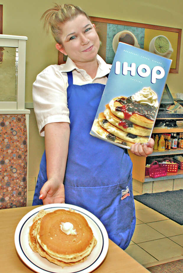 Gordon Zeigler/Plainview HeraldJennifer Lovell serves up a short stack of free pancakes . . . the same plate to be given free at the Plainview IHOP, I-27 and US 70, on Tuesday as part of the IHOP National Pancake Day Celebration. Free pancakes will be served from 7 a.m. to 10 p.m. to benefit Shriners Hospitals for Children. All the firm asks is that diners consider a charitable donation to the Shriners as part of Make Miracles Happen for Kids.