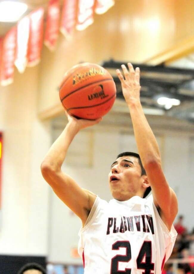 The Plainview Bulldogs' Chris Salazar puts up a short jump shot during a District 3-4A game against the Caprock Longhorns on Tuesday in the DogHouse. Photo: Ryan Thurman/For The Herald