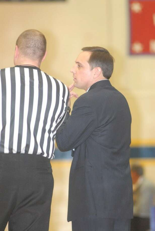 Wayland Flying Queens coach Tory Bryant visits with a referee during a game Thursday in Hutcherson Center. Photo: Kevin Lewis/Plainview Herald