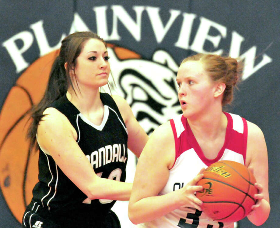 Plainview junior post Bailey Davis (right) prepares to make her move against a Randall defender during Friday night's game in the DogHouse. (See story, Page 2B.) Photo: Doug McDonough/Plainview Herald