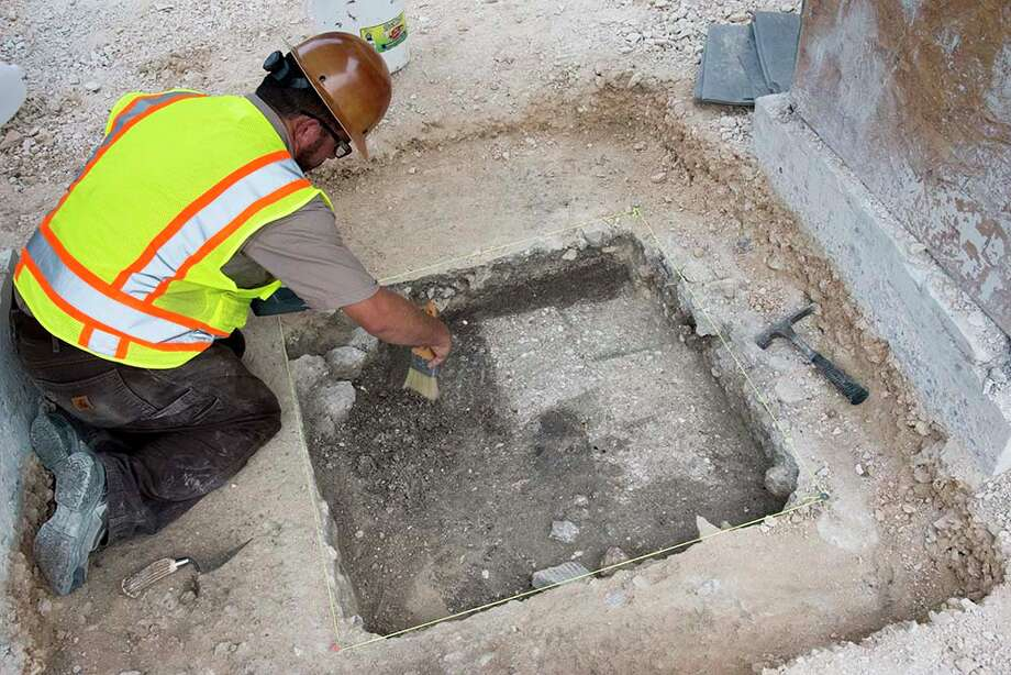 Archaeologists conducting investigative digs in Alamo Plaza on Monday reported uncovering part of an adobe wall, a link to the Spanish colonial period, in the southwest corner of the plaza. Photo: Texas General Land Office