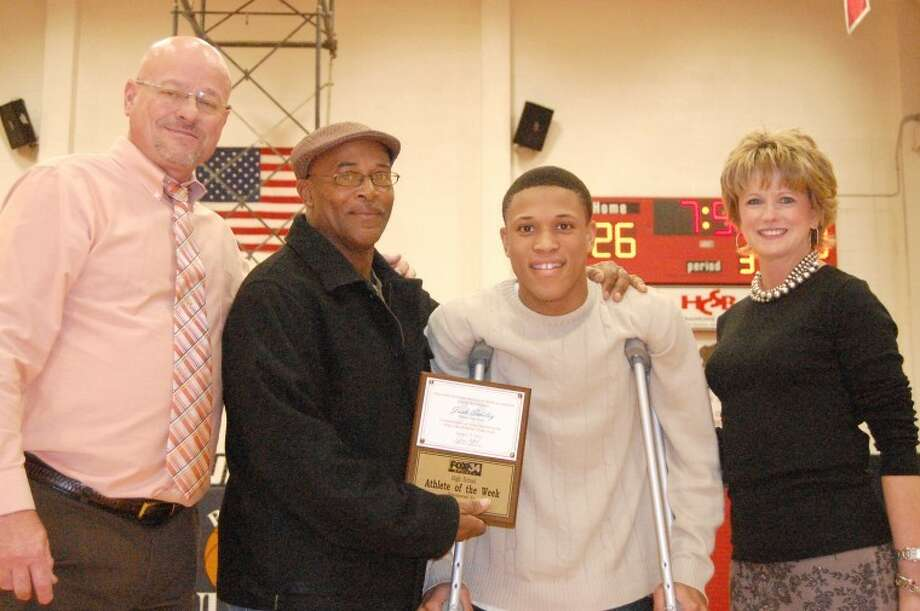 Plainview High senior Josh Smiley was presented the FOX34 Athlete of the Week award, sponsored by State Farm Insurance, during Friday night's doubleheader in the DogHouse. Smiley, who recently suffered a season-ending knee injury, is shown with Bulldog coach Leon Hagerman, his dad Carl Smiley and State Farm agent Jan Alford.