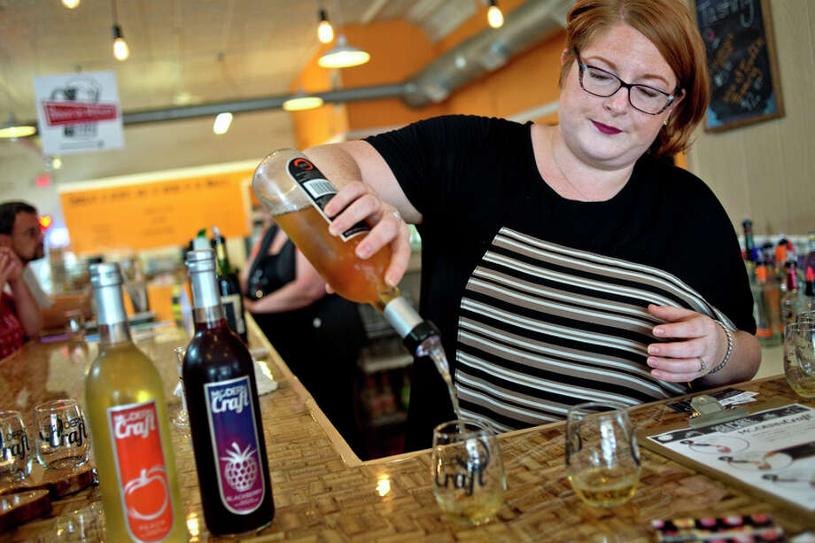 Modern Craft director of events Liberty Starkweather Smith makes drinks using Modern Craft wine at the Modern Craft tasting room inside Brewin' On McEwan in downtown Clare. / Midland Daily News