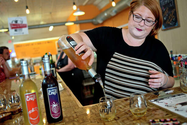 Modern Craft director of events Liberty Starkweather Smith makes drinks using Modern Craft wine at the Modern Craft tasting room inside Brewin' On McEwan in downtown Clare.