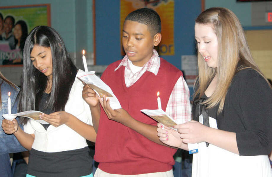 New inductees Analisa Villa (left), Christian Wallace and Mallory Watson recite the National Junior Honor Society pledge during the NJHS Induction Ceremony, held Tuesday evening at Estacado Junior High. Photo: Jan Seago/Plainview ISD