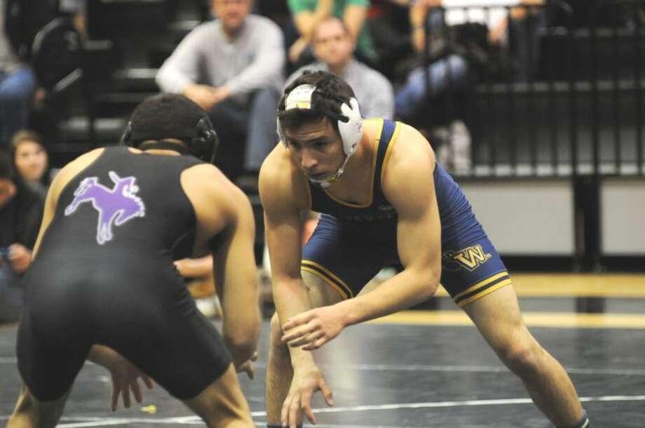 WBU wrestler John Mark Avila, won by pin in the gym at his alma mater, Canyon Randall. Photo: Wayland Baptist University Photo
