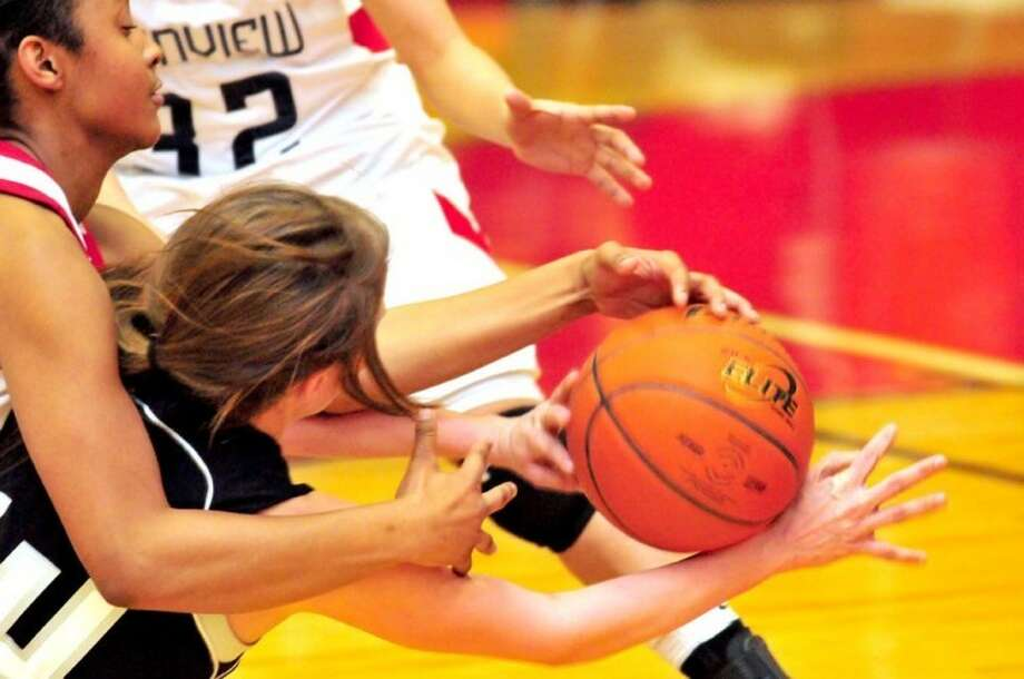Plainview Lady Bulldog Taivia Hearn (left) goes after a loose ball in a recent game against Canyon Randall. No. 19 Plainview lost to No. 5 Canyon on Tuesday 44-30. Plainview plays at Hereford on Friday.