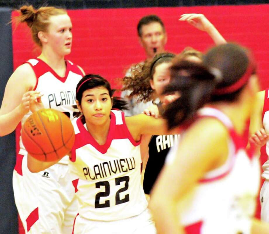 Plainview Lady Bulldog Michelle Portillo (22) looks down the floor as she anticipates passing to a teammate during a game last week against Randall. The No. 19 Lady Dogs take on No. 5 Canyon at 6 p.m. today in Canyon, before the Bulldogs meet the Eagles at 7:30. The games can be heard on KKYN (106.9 FM.)