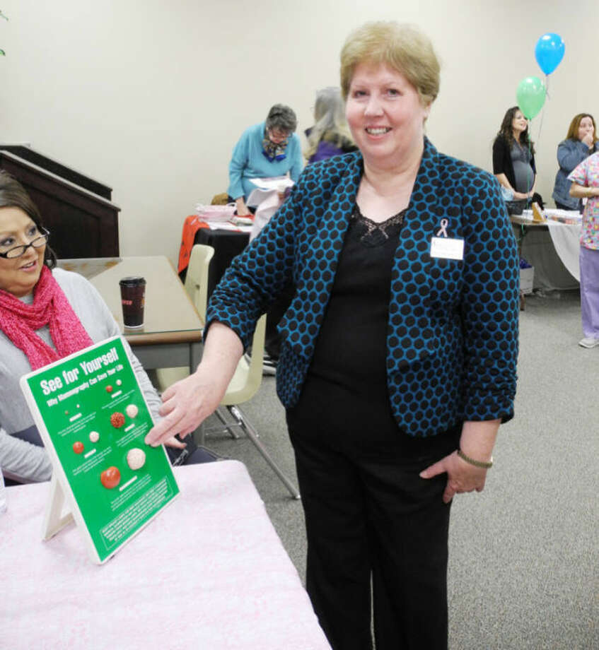 Cheryl Brewer, a Texas A&M AgriLife cancer prevention specialist, uses visual aids to show various states of breast cancer. Photo: Gail M. Williams | Plainview Herald