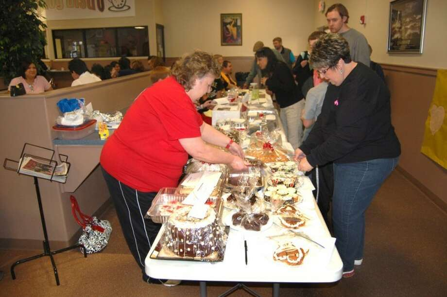 Doug McDonough/Plainview HeraldSherrie Greggs (left) and Pat Allen check bids on cakes and pastries offered Friday in a silent cake auction to benefit Plainview Stars Special Olympics. The cake auction was coordinated by Plainview High School Student Council. It and a companion memorabilia auction featuring items donated by NBA basketball great Bill Walton were held Friday in conjunction with the annual Lions Club Pancake Supper and the Plainview High vs. Canyon Randall basketball games.