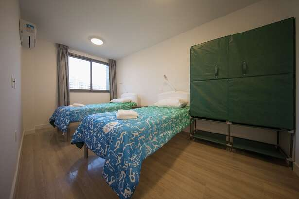 A bedroom of one of the units within the Olympic and Paralympic Village for the 2016 Rio Olympic Games. The Village will host up to 17,200 people amongst athletes and team officials during the Games and up to 6,000 during the Paralympic Games on July 22, 2016 in Rio de Janeiro, Brazil.