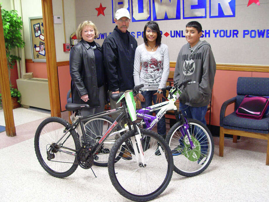Courtesy PhotoRotarians Coralyn Dillard and Kenneth Hooper are pictured with Ash students Jevon De La Cerda and Krystal Longoria after presenting the sixth graders with bikes as part of the Plainview Rotary Club's perfect attendance program. Other winners of bikes or iPods for the third six-week grading period were: Lakeside, Harlan Shafer and Lauren Hukill; Coronado Jr. High, Ezequiel Garcia and Sylvia Lopez; Estacado Jr. High, Ruben Salina and Libby Jolly; Houston School, Isabella Vargas; and PHS, Megan Bordayo, Stratton Mowery and Shelby Summers.