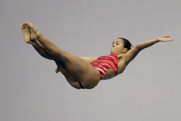 Kassidy Cook performs during the women's three-meter springboard final at the U.S. Olympic diving trials Sunday, June 26, 2016, in Indianapolis. Cook won the event. (AP Photo/AJ Mast)