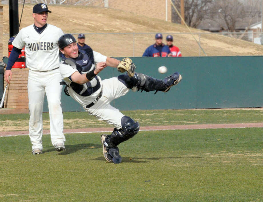 Wayland catcher Tyler Doolittle throws to first base after fielding a bunt while pitcher Craig Cook looks on during Friday's season-opening doubleheader against University of the Southwest at Wilder Field. The Pioneers lost the first game, 4-2, then won the second game, 3-2 in 10 innings. Doolittle struck out seven batters in 3 1/3 innings in game two. Wayland and USW, which is coached by Plainview native Mike Galvan, played another doubleheader on Saturday in Hobbs. Photo: Wayland Baptist University Photo
