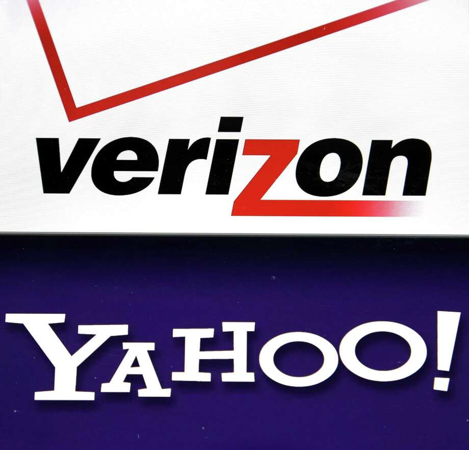 Verizon Communications Inc. is getting close to a renegotiated deal for Yahoo Inc.'s internet properties that would reduce the price of the original $4.8 billion deal by about $250 million, according to people familiar with the matter. Their logos are shown on a laptop. Photo: Associated Press /File Photo / AP