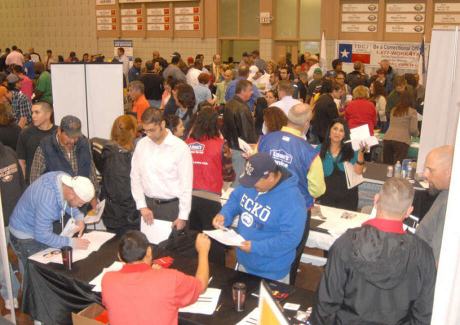 Scores of former Cargill Meat Solution employees, put out of work with last week's closure of the local beef packing plant, crowd around various job recruiters Wednesday at a Texas Workforce Commission-sponsored employment fair at the Ollie Liner Center. Sixty-six businesses and organizations set up tables at the jobs fair, with about 1,100 prospective workers participating in the day-long event. Photo: Doug McDonough/Plainview Herald