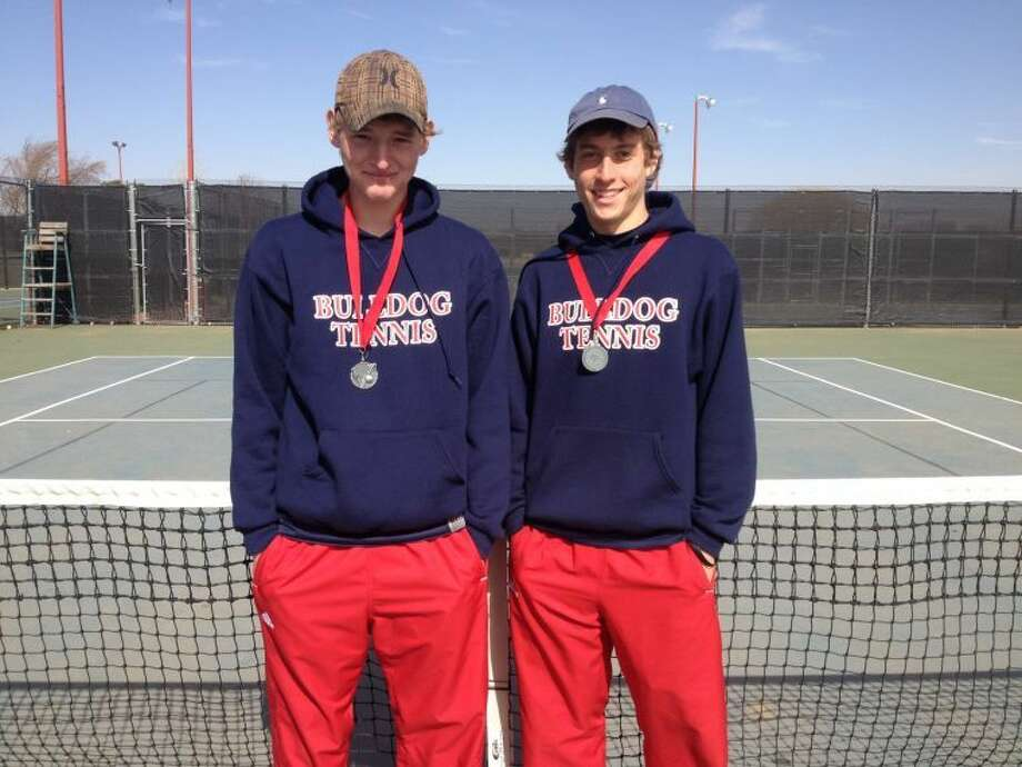Bulldog tennis players Jeremy Brush and Andrew Cunningham show off their second place medals from the Hub City Classic tennis tournament in Lubbock. Photo: Courtesy Photo