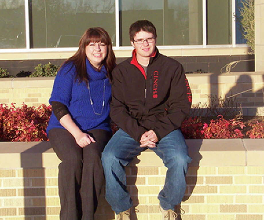 Amy Lane Hagerman and Cody Lane sit in front of Plainview High School. Hagerman taught economics to her cousin, who is now a PHS senior. Hagerman is the oldest grandchild of Birt and Pat Lane while Lane is the youngest. There have been Lane children, grandchildren and now great-grandchildren continuously enrolled in Plainview public schools now for 55 years. Photo: Jessica Thornton/Plainview Herald