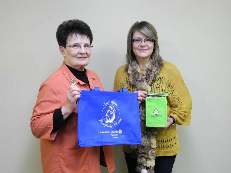 Janice Posey, president of Covenant Plainview Auxiliary, and Ginny Rawls, lactation consultant, hold up totes given to breast-feeding moms when they leave the hospital with their new babies. Photo: Gail M. Williams | Plainview Herald