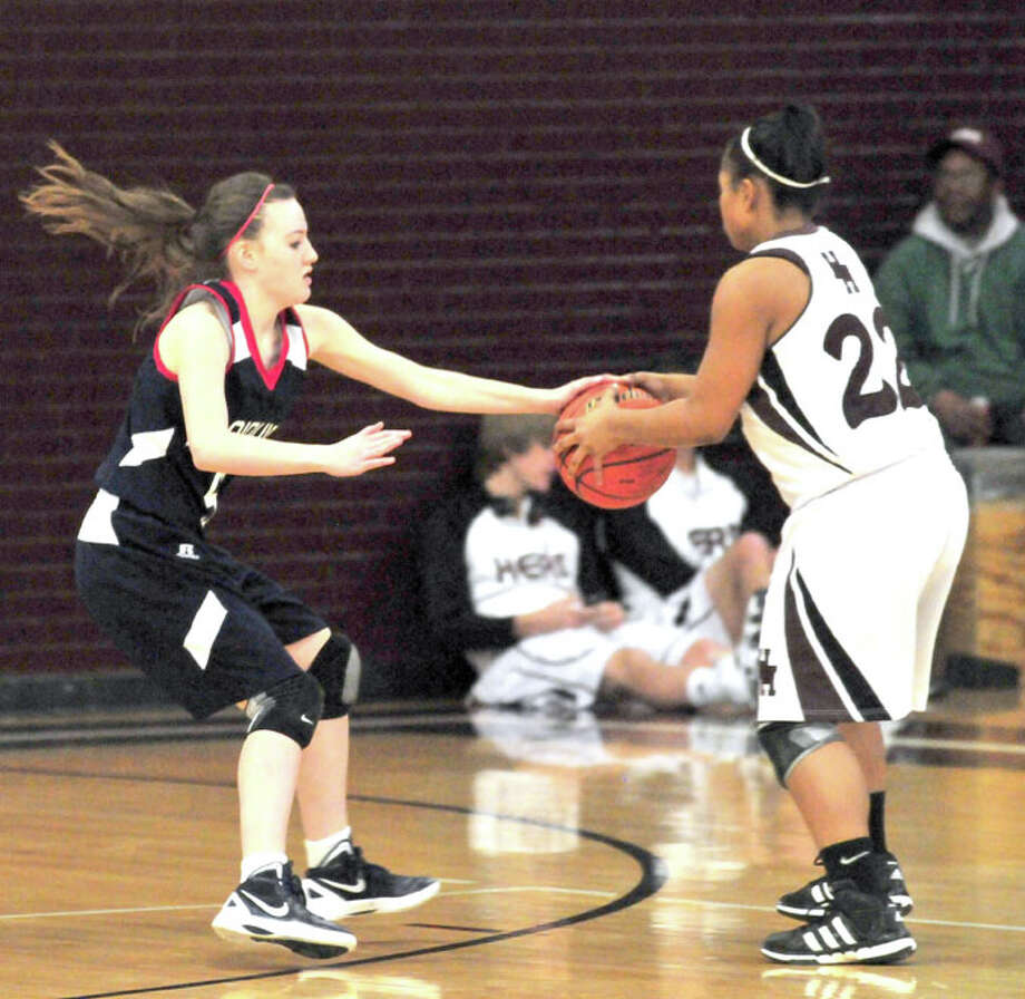 Lady Bulldog freshman Meredith McDonough (left) attempts to steal the ball from Hereford's Summer Brown (22). Photo: Doug McDonough/Plainview Herald