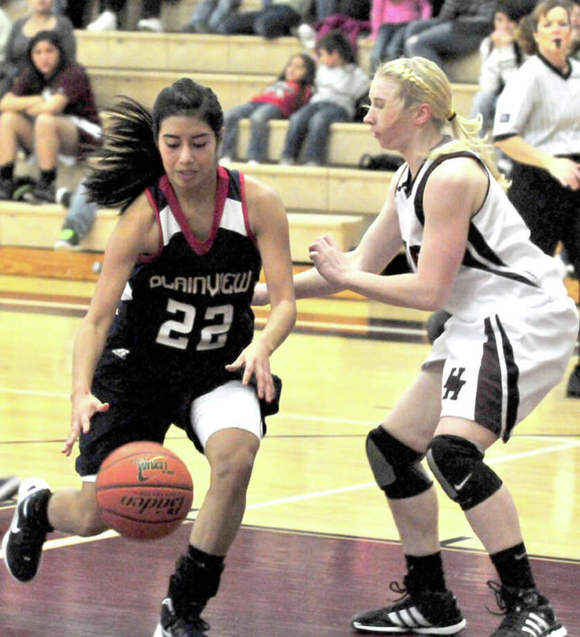Plainview Lady Bulldog Michelle Portillo (22) drives to the basket during Friday's game against Hereford. The No. 21 Lady Bulldogs wrap up the regular season today by hosting Palo Duro at 6 p.m. The Bulldogs, who have won a season-high four straight, host the Dons at 7:30.