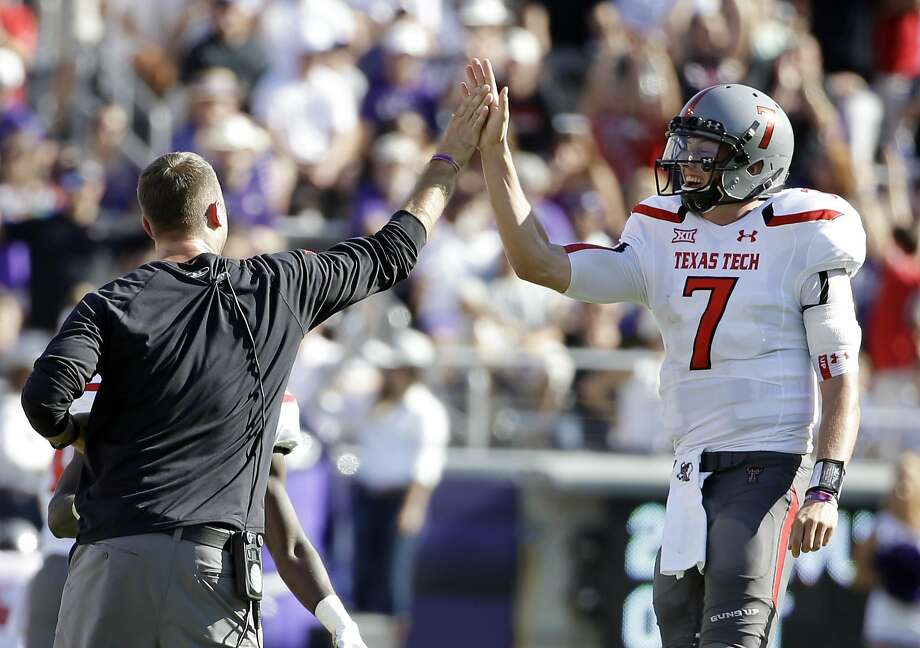 Texas Tech head coach Kliff Kingsbury, left, celebrates with quarterback Davis Webb (7) after a touchdown against TCU in the first half of an NCAA college football game, Saturday, Oct. 25, 2014, in Fort Worth, Texas. (AP Photo/Tony Gutierrez) Photo: Tony Gutierrez, Associated Press