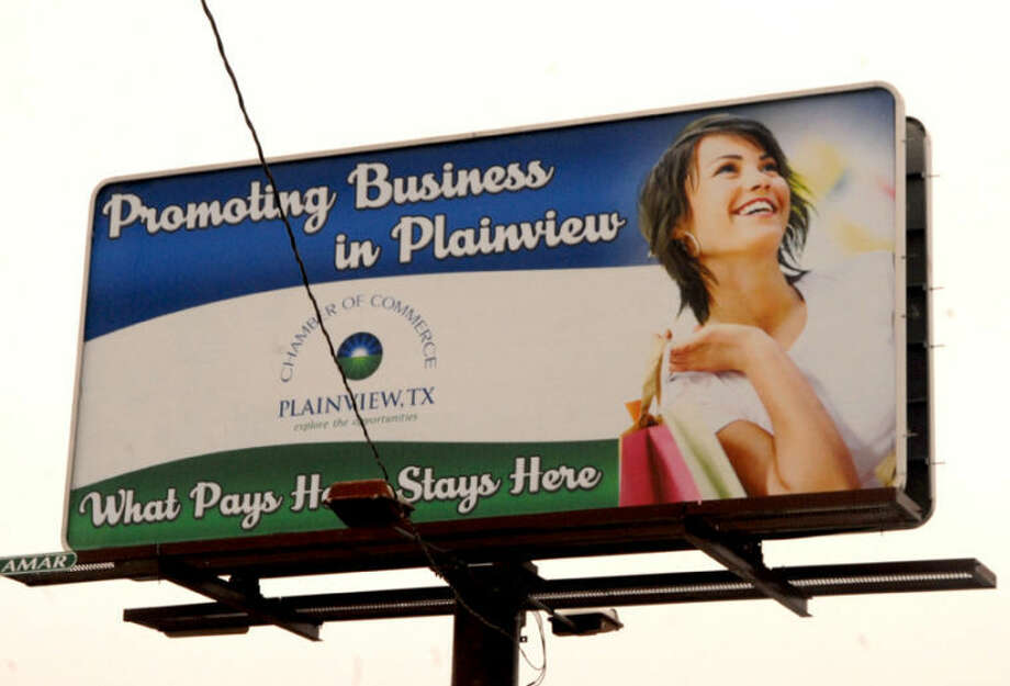 "Doug McDonough/Plainview HeraldA double-sided billboard at Fifth and Denver is part of a current Chamber of Commerce media campaign to promote the local economy. The sign states: ""Promoting Business in Plainview — What Pays Here, Stays Here."" Photo: Doug McDonough/Plainview Herald"