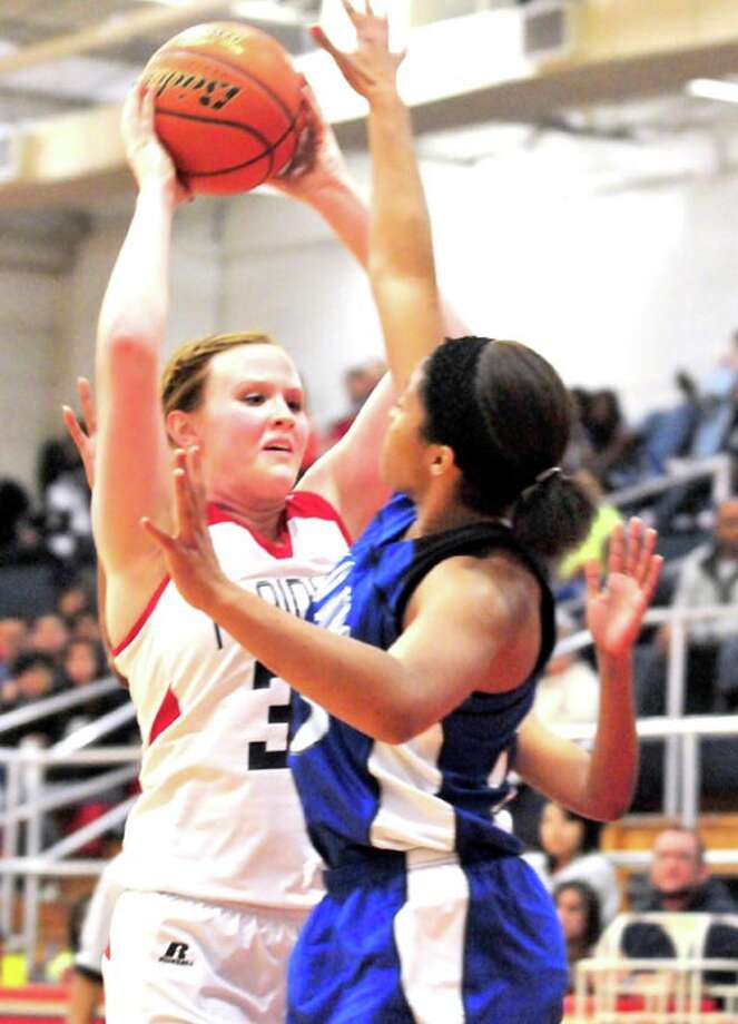 The Plainview Lady Bulldogs' Bailey Davis (left) is defended by Palo Duro's Jericka Smith during a District 3-4A game Tuesday in the DogHouse. Photo:  Ryan Thurman/For The Herald