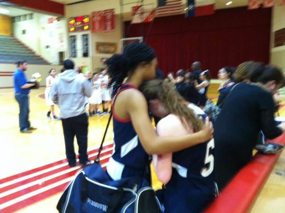 Lady Dog Taivia Hearn consoles teammate Meredith McDonough after Tuesday's 49-43 overtime loss against El Paso Hanks. Photo: Doug McDonough/Plainview Herald