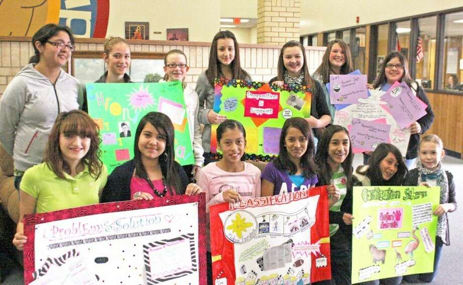 Jan Seago/Plainview ISDStudents in Melinda Thomas' advanced reading classes at Coronado Junior High worked in small groups to create posters on text organization for a poster contest. Shown displaying the posters that won best poster in each classroom are Kimberly Rodriguez (front left), Gina Rodriguez, Lee Ann Grimaldo, Priya Bhakta, Andie Rodriguez, Lesly Sanchez, Ashlynn Stennett, Natalie Hernandez (back left), Sterling Skinner, Colti Wright, Amela Dizdarevic, Taryn Garza, Emmy Powell and Mary Beth Sanchez.