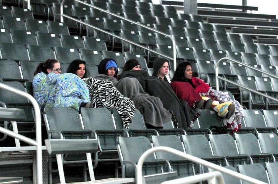 Kevin Lewis/Plainview HeraldThese six Wayland students - Natasha Giacomazzi (left), Megan Huerta, Kristy Hannah, Amanda Ramirez, Heather Choat and Amanda Hinojosa - try to stay warm as they watch the Wayland baseball team play Sul Ross State on Monday afternoon. Temperatures were near freezing with a wind chill well below that. By Wednesday morning the mercury dipped to 16 degrees before climbing into the upper 40s by late afternoon. The forecast calls for highs in the lower 50s and a 20-30 percent chance of light rain today and Friday. Another chance of precipitation, possibly snow, returns Sunday.