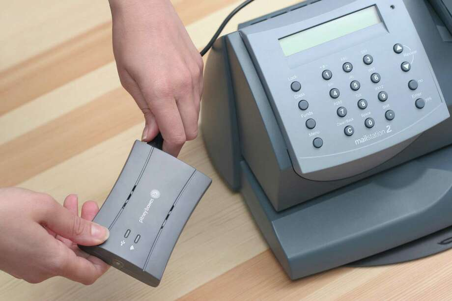 Pitney Bowes has launched its SmartLink, which connects postage meters to the company's cloud computing system. Photo: Contributed Photo