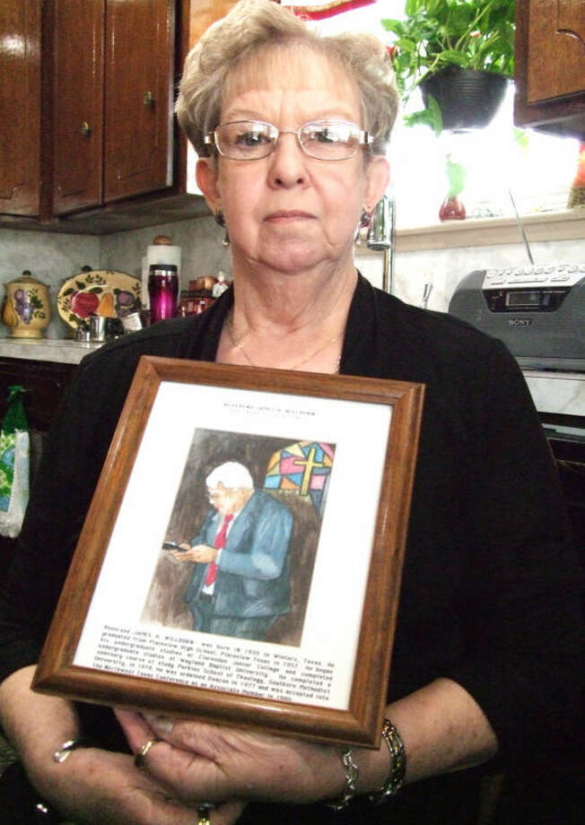 Carlene Willborn sits in her late husband's favorite chair with a painting of him created by Travis Bennett, artist and former associate pastor at First United Methodist Church. Photo: Shanna Sissom/Plainview Herald