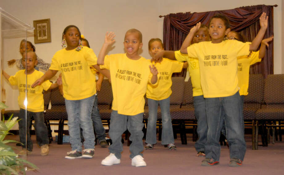 """Members of the """"Omegas"""" youth group offer a choreographed presentation during Sunday's Black Awareness Celebration Finale held at Finney. Photo: Doug McDonough/Plainview Herald"""