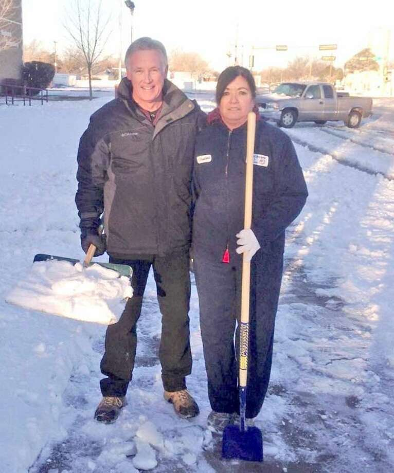 Plainview ISD Superintendent Dr. Rocky Kirk and Highland custodian Elizabeth Moreno pause while shoveling snow from the sidewalks at Highland Elementary early Tuesday. Photo: Courtesy Photo