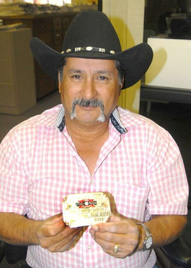 Doug McDonough/Plainview HeraldCirildo Leal displays the second round championship buckle from the 2012 Pro Bull Riders Built Ford Tough World Finals. Leal received the buckle from two-time world champion Chris Shivers, who won it Oct. 25 in Las Vegas.
