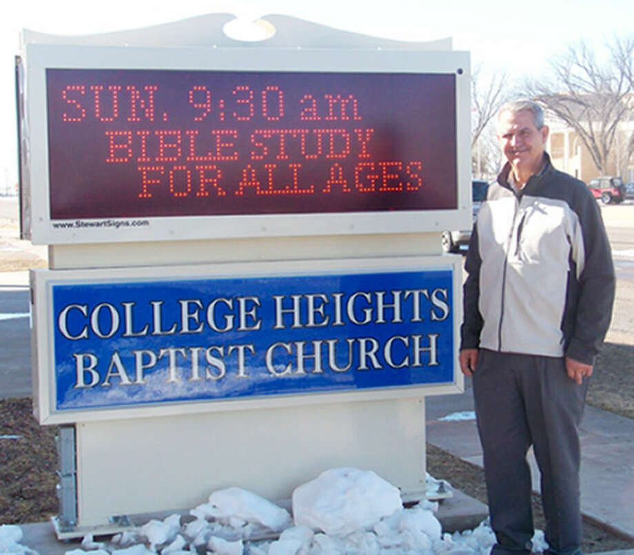 The Rev. Don Robertson, pastor of College Heights Baptist Church, stands next to the church's sign which was placed in September 2011. Robertson steps down as pastor after services on Sunday. Photo: Jessica Thornton/Plainview Herald
